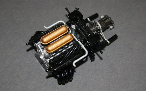 Here's a tip for anyone doing this kit: cement individual exhausts into the collector first, then line them up in the engine block – not the other way around! As a result, my exhausts are a little askew.