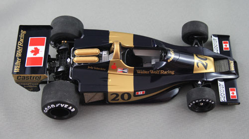 Swooping curves and wide hips. All the gold, other than the roll hoop and injector covers, is decal. Getting them to snuggle down on those curves, especially the nose decal, took a LOT of time. The Goodyear lettering on the tyres is painted by hand.