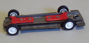 Assembly starts. Axles are added to the chassis plate, as are the tyres. No other changes are made.