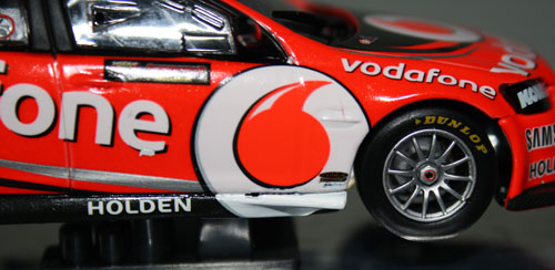 Huge decal covers the entire side of the car and the red inside the logo is different to the red body colour. There's a white blotch under the 'e', air under the logo at the side light and a gap and mess between the side skirt and bottom of the door. These were all issues (except for the blotch) on the Lowndes 2012 'season' car I'd already purchased a month or so back.