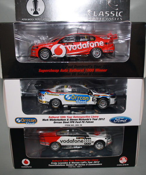 """The 2012 Bathurst 1000 race winning Vodafone entry (top) and two of the special """"50th Year of Bathurst"""" retro livery cars. The packing is the usual job from Classics, loosely aligned with the colour scheme of the car and includes the numbered Certificate of Authenticity - nice touches if you are into that sort of thing (I'm not. I just see it as unnecessary additional expense)."""