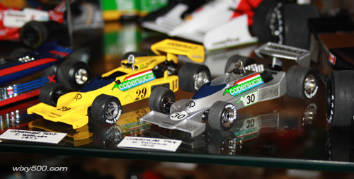 In the display cabinet alongside Emmo's silver 1976 version. As per the '76 model, the yellow car had changes from one race to the next. As such, my model does not represent a configuration from any specific race, it's simply a general representation of the FD04 from 1977.