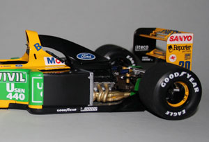 Back-end detail. The big 'United Colors of Benetton' decals on the sidepod need to be applied with the engine cover in place, then sliced down the bodywork gap with a razor. Same with 'Benetton' and 'Mobil' on the yellow part.
