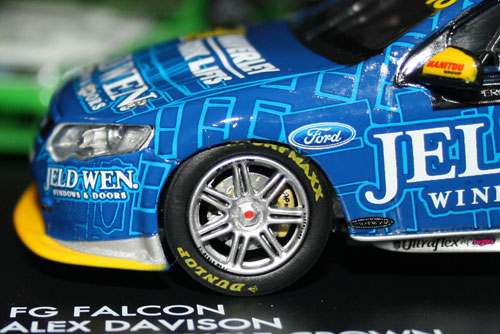 Nice wheel detail. My opinion is the wheel rim itself does not appear 'alloy' enough and should be shinier. Minor QC issues with spray masking (bottom of splitter) and decal overlap (near Ford logo). But remember, this is 1:43 scale, not 1:18.