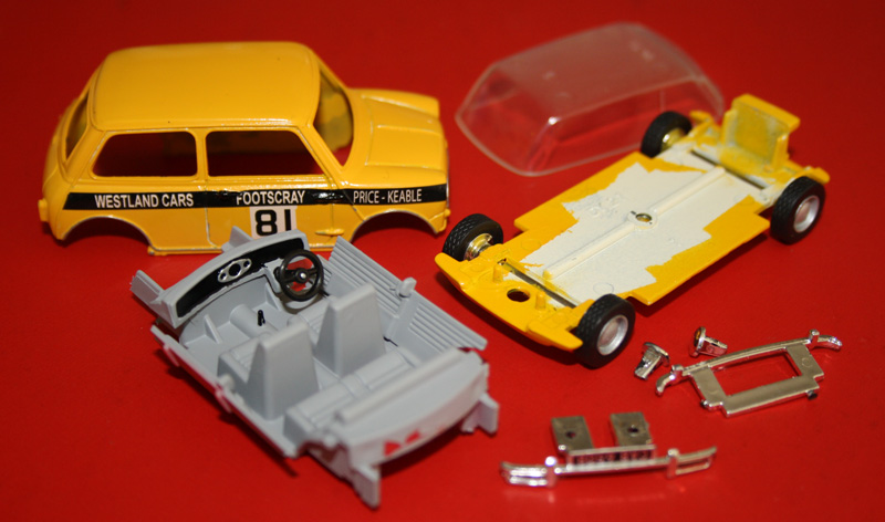 All the parts almost ready for re-assembly. The interior was hit with grey plus some detail picked out by hand brush. I sourced some Mini Light wheels with tyres that were supposed to be 1:43 scale and suitable for a Mini, but once they arrived, I discovered they were far to big in diameter and would not even fit inside the guard cutouts properly. Unfortunatley had to return to the stock wheels and the mini Lights might get used on another project