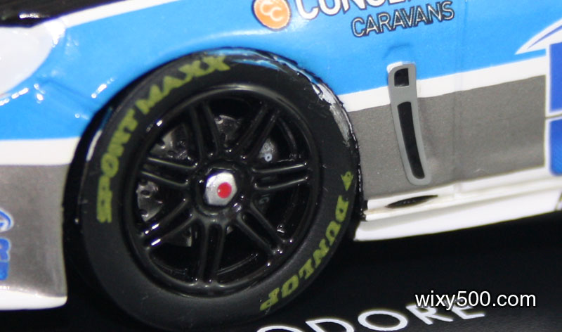 Decal 'overspray'(?!) on the tyre and poorly positioned vent