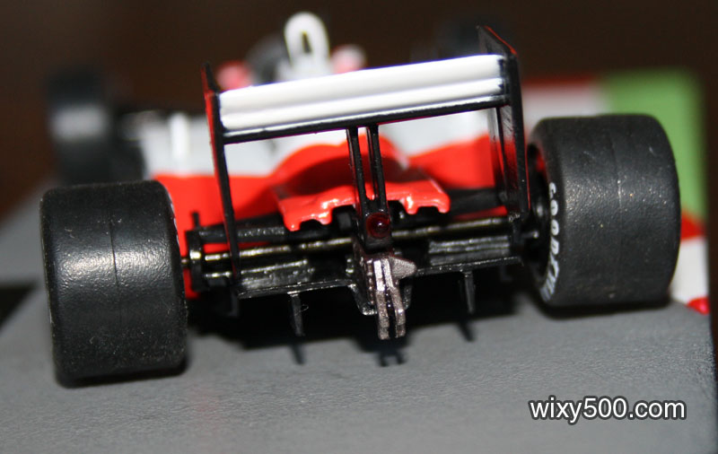 Rear-end detail shows diffuser, gearbox, jack point, rain light, basic suspension, fixed axle and wonky wheels