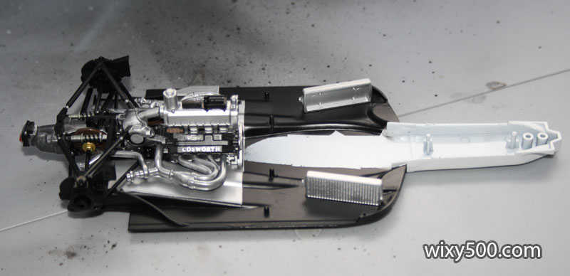 Engine/gearbox/rear suspension assembly, plus the radiators, clipped into the floor tray