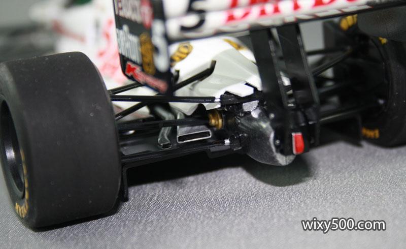 Left-side exhaust and wastegate exits between the suspension arms